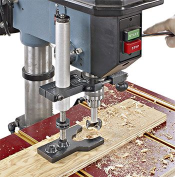 Drill press hold down attaches to shaft and clamps the board to ...