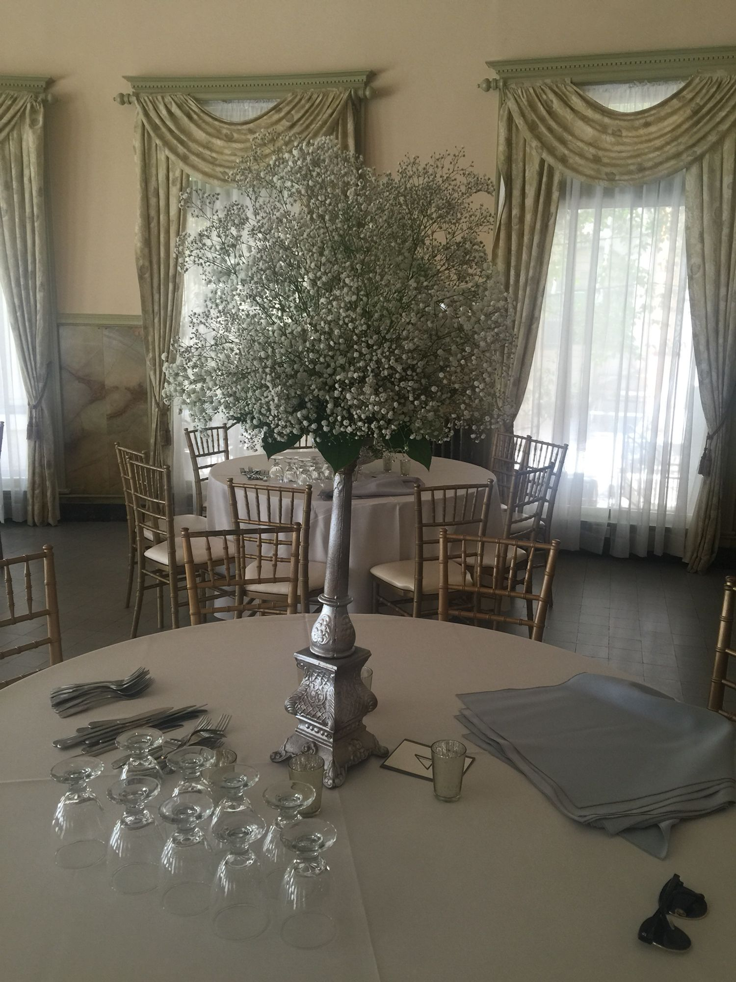 tall centerpiece in silver candlesticks castle green hotel