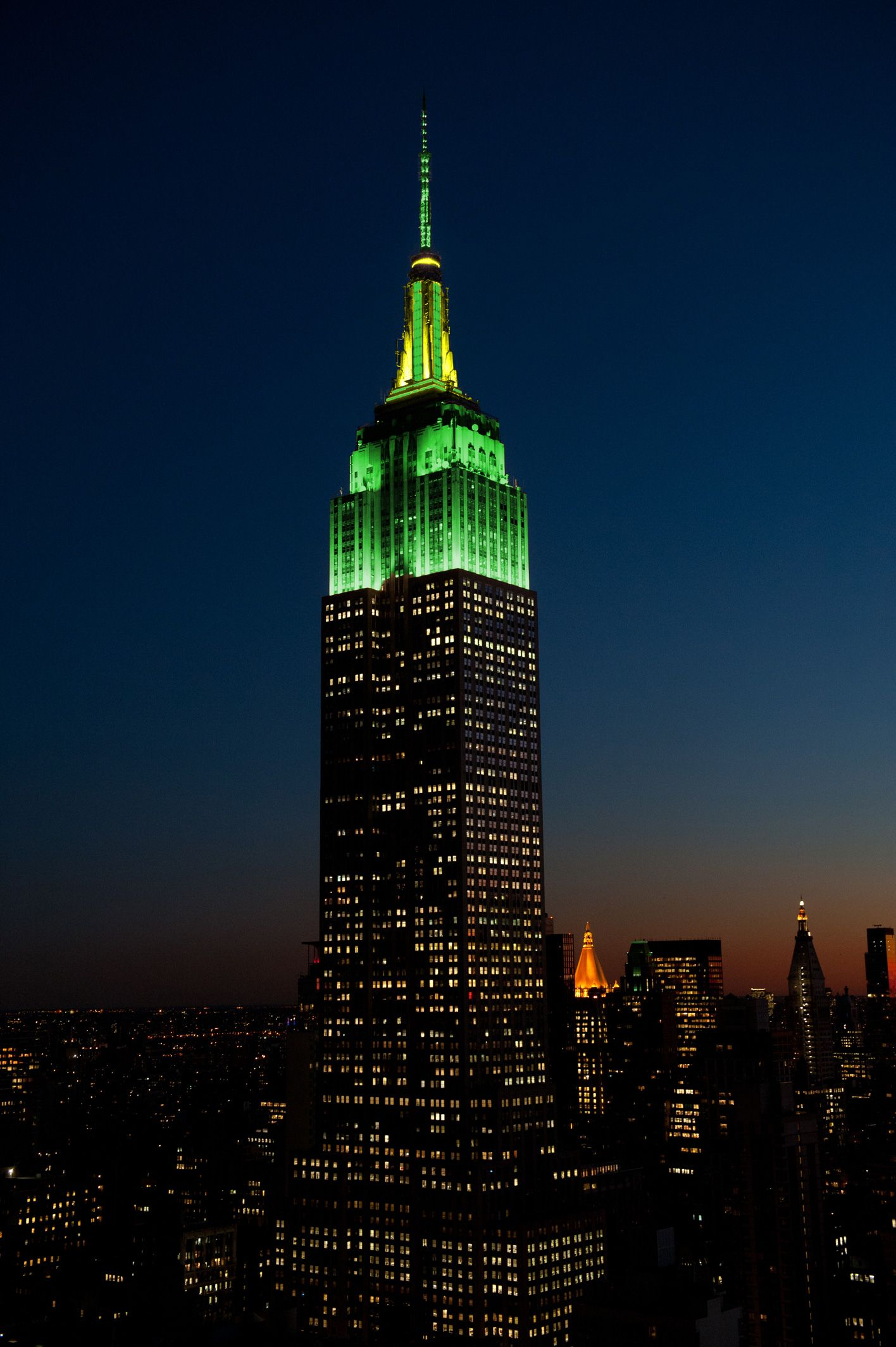 April 13, 2015: To celebrate the 2015 Masters Tournament, the Empire State Building glows in golf course green and yellow