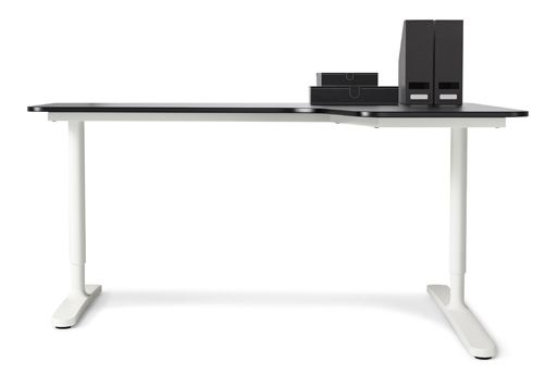 An IKEA BEKANT office desk with white legs and black worktop