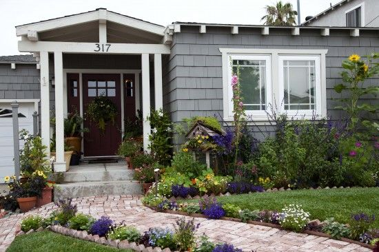 a small front lawn surrounded by a charming cottage style planting of edibles and - Front Yard Cottage Garden Ideas