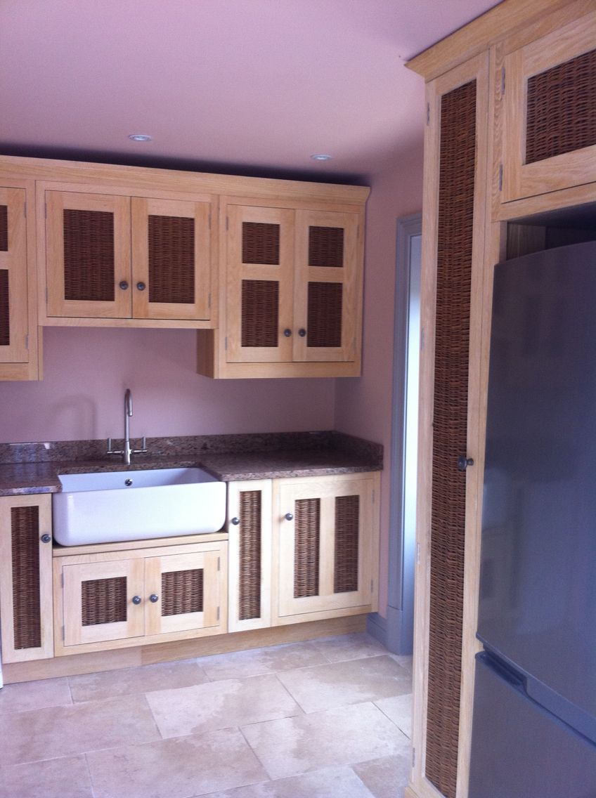 Bleached oak kitchen with wicker panels custom house interiors