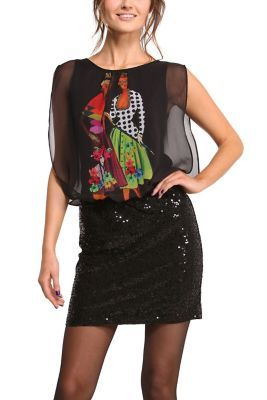 If you want to look sexy but fun, look no further than this black party dress. It's loose at the top and silky-looking but the fun comes from the print pattern and the sequined skirt. Made in Spain.