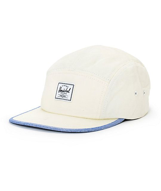 ac2d200278e Update your comfort with a low-profile 5 panel natural design with a blue  chambray bill detailing and a Herschel Supply logo patch at the front.