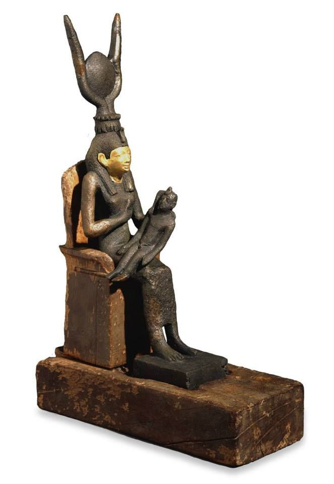This bronze figure of Isis and Horus is from from North Saqqara, Egypt from the Late Period, after 600 BC. Family groups of deities became very popular in the Late Period (661-332 BC), and were placed in temples by wealthy individuals. The most important group of deities was the triad (a group of three persons) of Osiris, his wife Isis, and their son Horus. They represented the king of the dead, the divine mother, and the living king respectively, together they were the perfect family.
