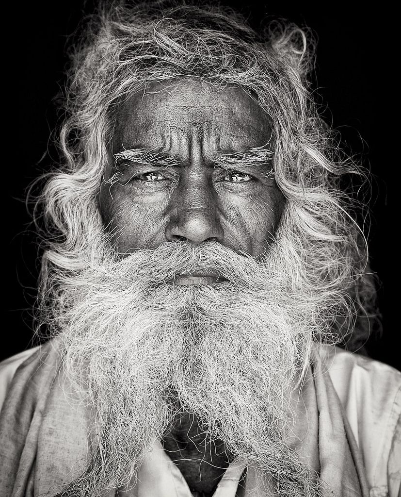 https://flic.kr/p/oRMqx1 | The Sadhus | I have been obsessed for many years and set of early 2013 to look for them: In hidden temples of crowded Delhi, on the bench of the holy river Ganga in Varanasi and close to the Himalaya mountains in Nepal. And I found them. Sadhus renounces his earthly life, all his worldly attachments, leaves home and family, and takes on the lifestyle of an ascetic. As part of this renunciation, they also leave behind their clothes, food and shelter, and live on…