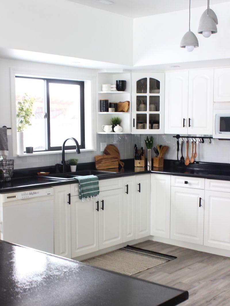 White Kitchen Cabinets With Black Countertops Are The Next Big Reno Trend Black Kitchen Countertops Kitchen Cabinet Design Black Countertops