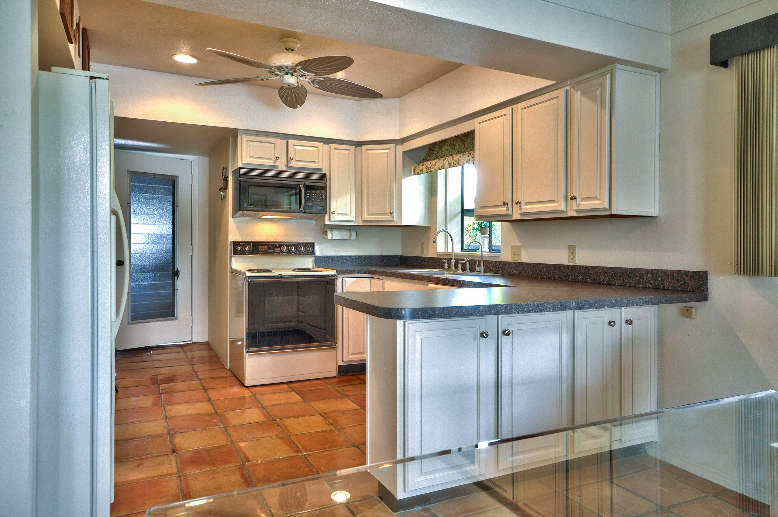 Eating Space in Kitchen: Updated almond kitchen cabinets ...