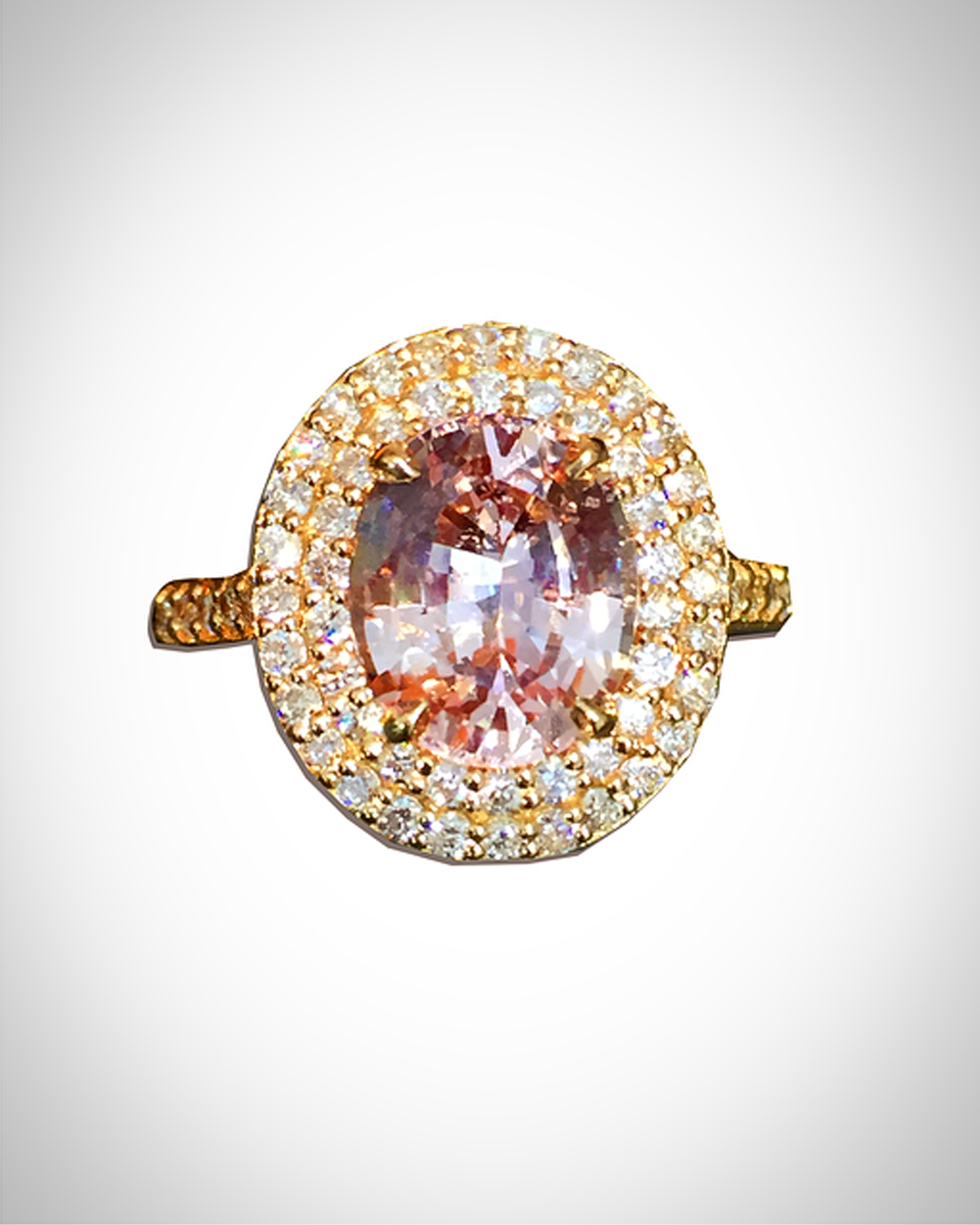 This peachy pink padparadscha sapphire engagement ring will make you