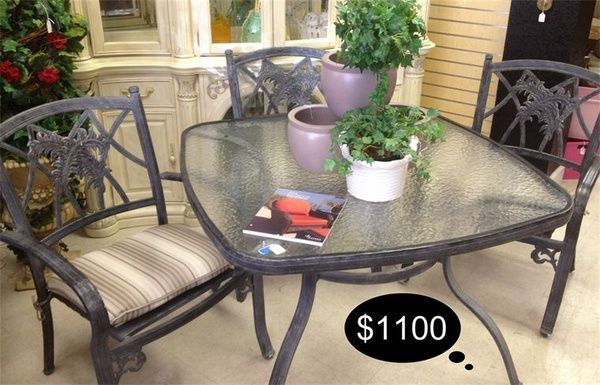 Gorgeous Patio World outdoor set - 4 ample chairs and a tempered glass table.