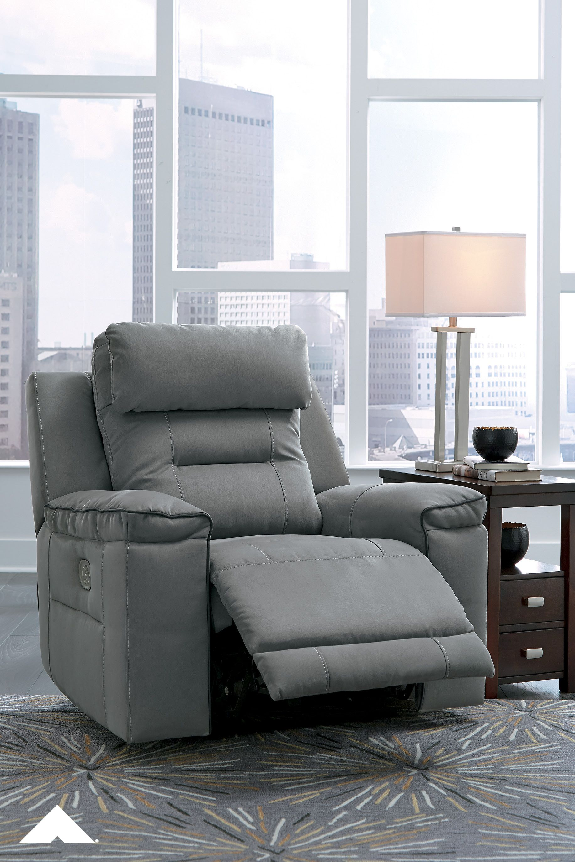 Trampton Smoke Recliner Looking To Get The Best Seat In The House This Stylish Power Recliner With Adjustable H Small Space Living Ashley Furniture Recliner