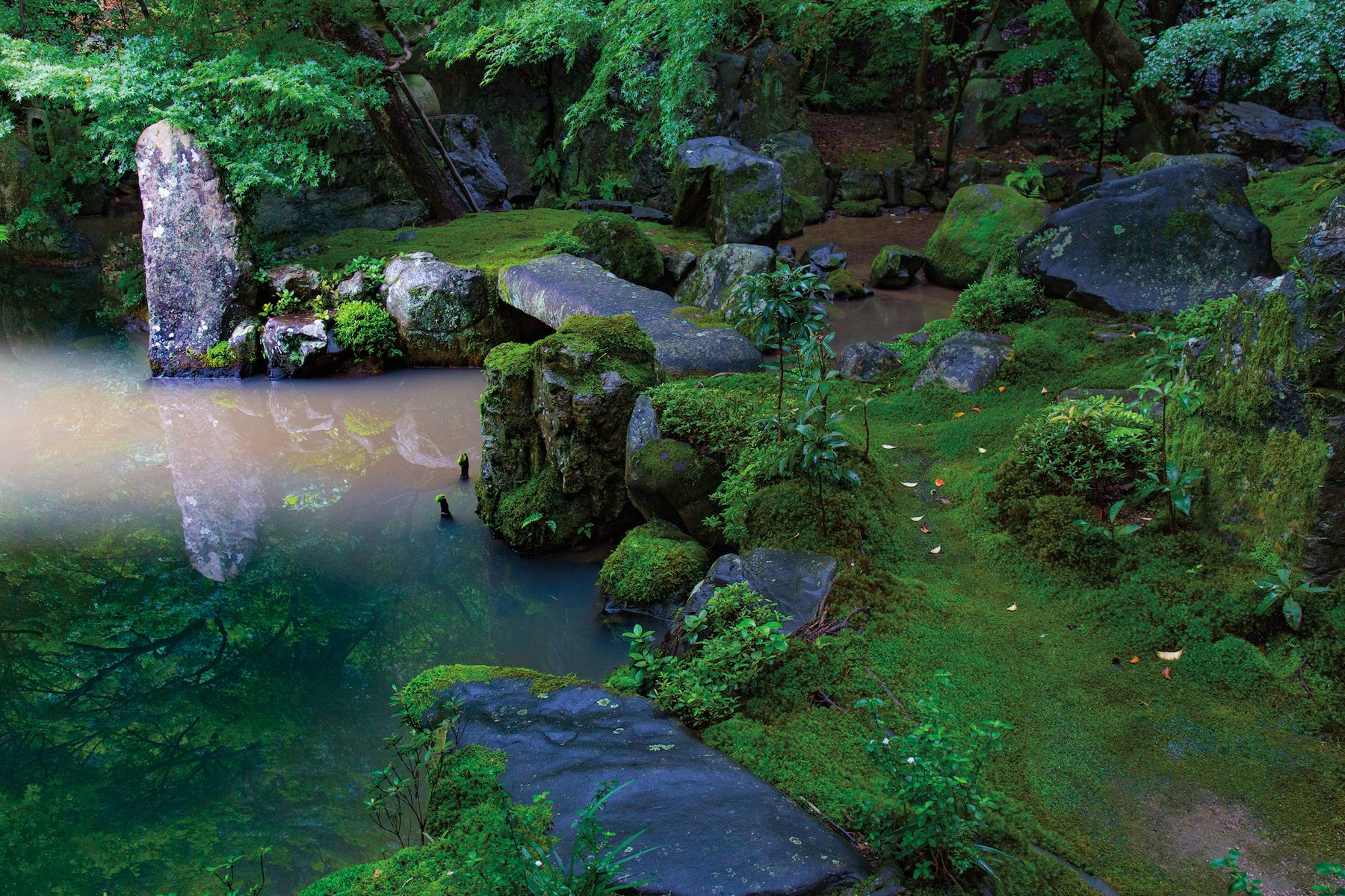 """Pond edge at Rengeji, Kyoto, Japan  """"A prominent stone and a bridge punctuate a shoreline made of smaller stones."""" —from """"Japanese Garden Notes""""   Pre-order to get a custom-printed 8 x 12"""" photograph from Japanese Garden Notes. https://stonebridgestore.squarespace.com/shop/japanese-garden-notes"""