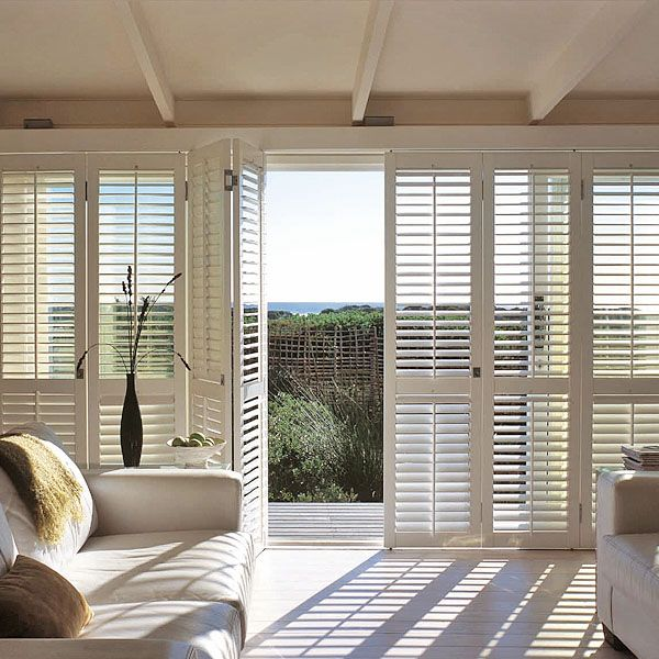 Bi folding shutters liverpool window blinds shutters for Interior window shutter designs