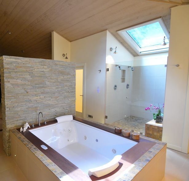 The master bathroom has a jacuzzi two person hot tub with for Bathroom jacuzzi decor