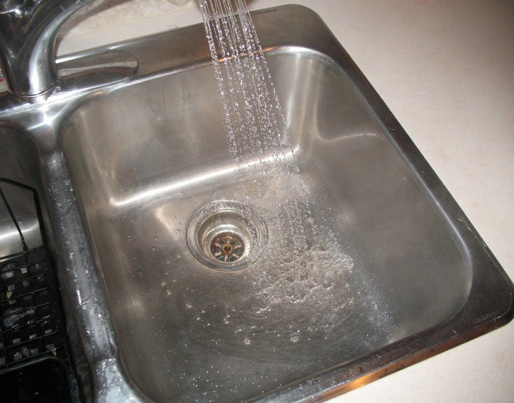 This is how I clean my stainless steel sink. It's a quick task that makes my kitchen sparkle!