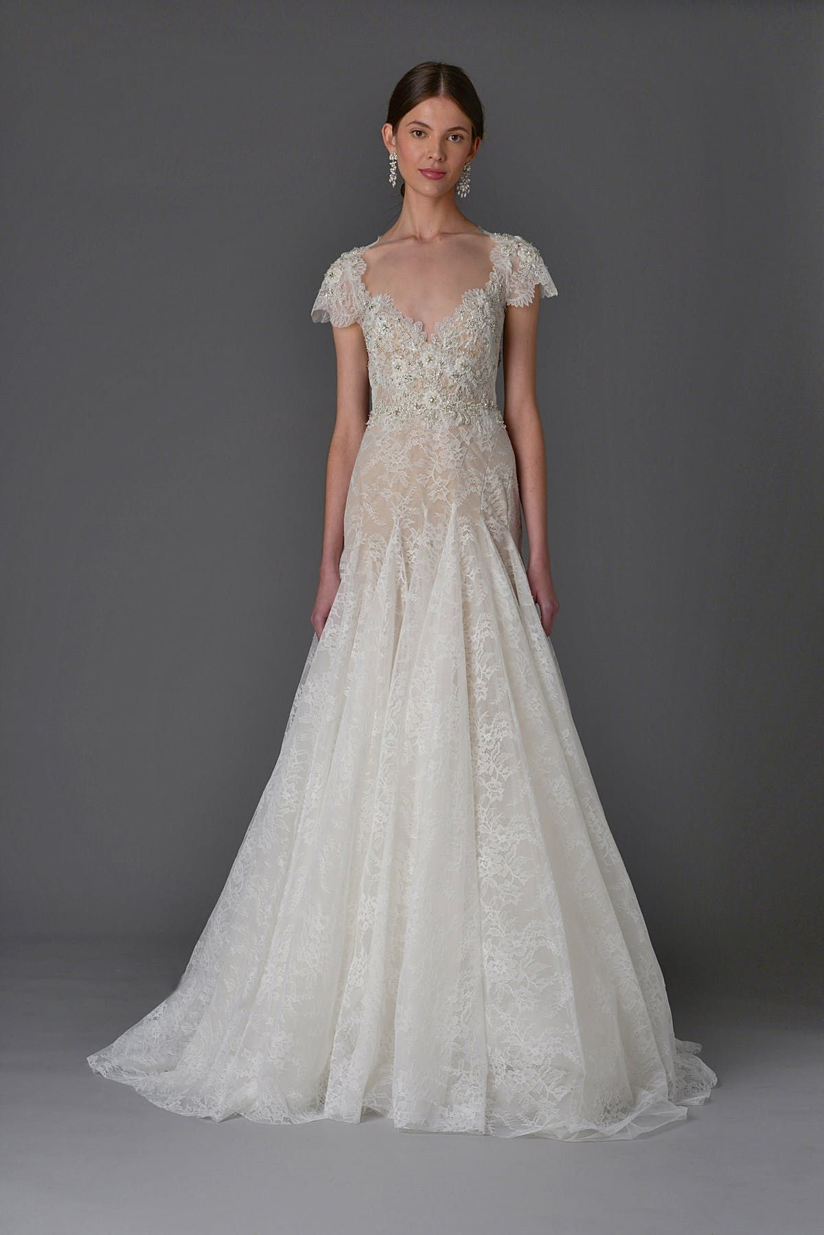 50eec5221e This Year's Hottest Trends with Marchesa #weddingdresstrends #lace #marchesa  Photo by FirstView