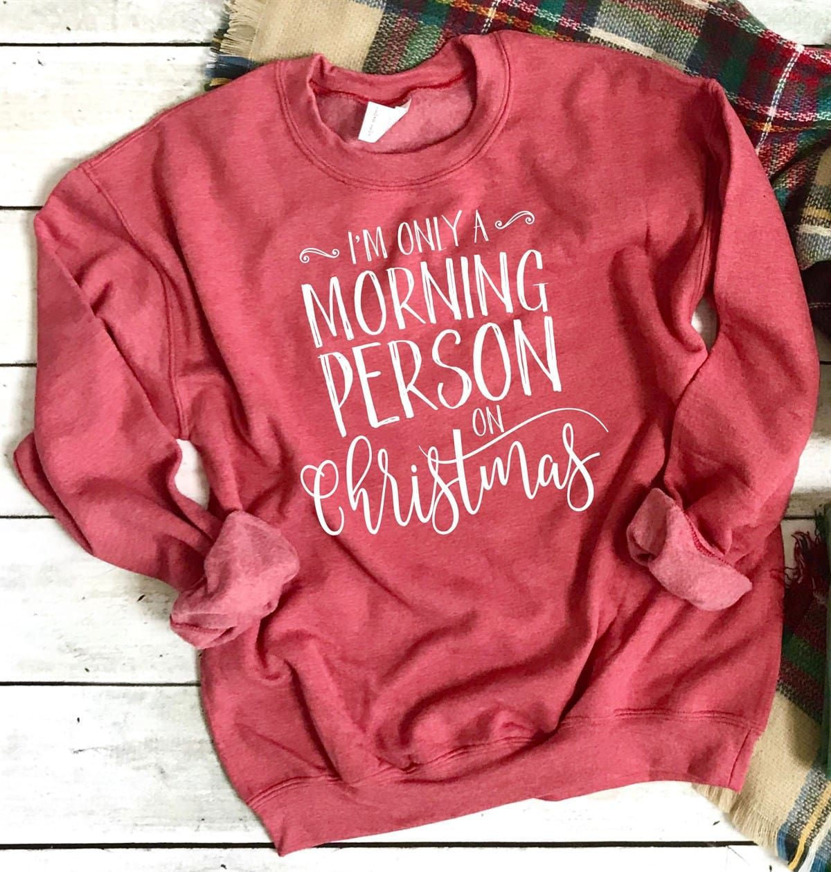 Soft and cozy holiday sweatshirts in graphic tees to please