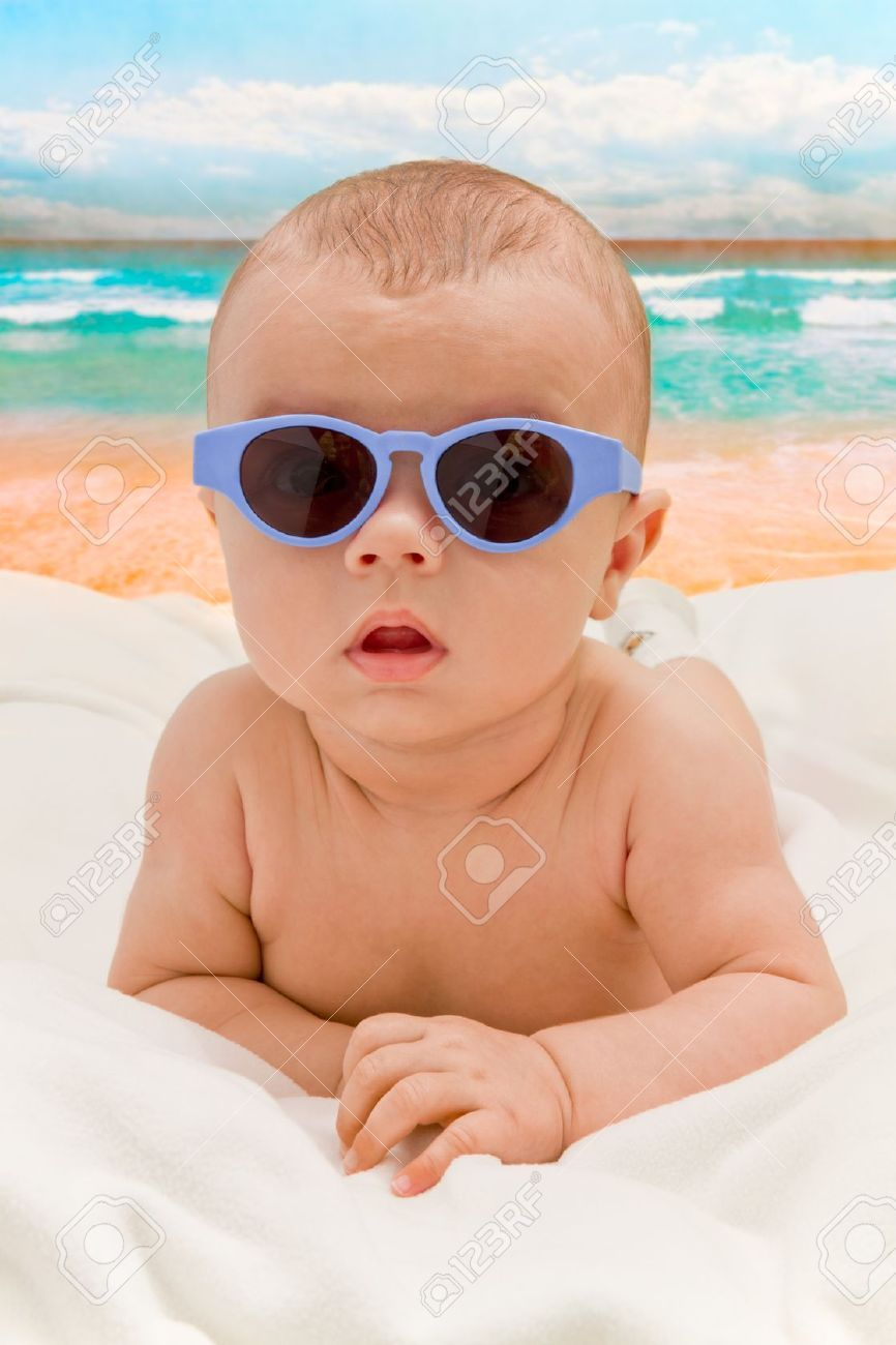 41cab654097 Funny Baby In Sunglasses On The Beach Stock Photo
