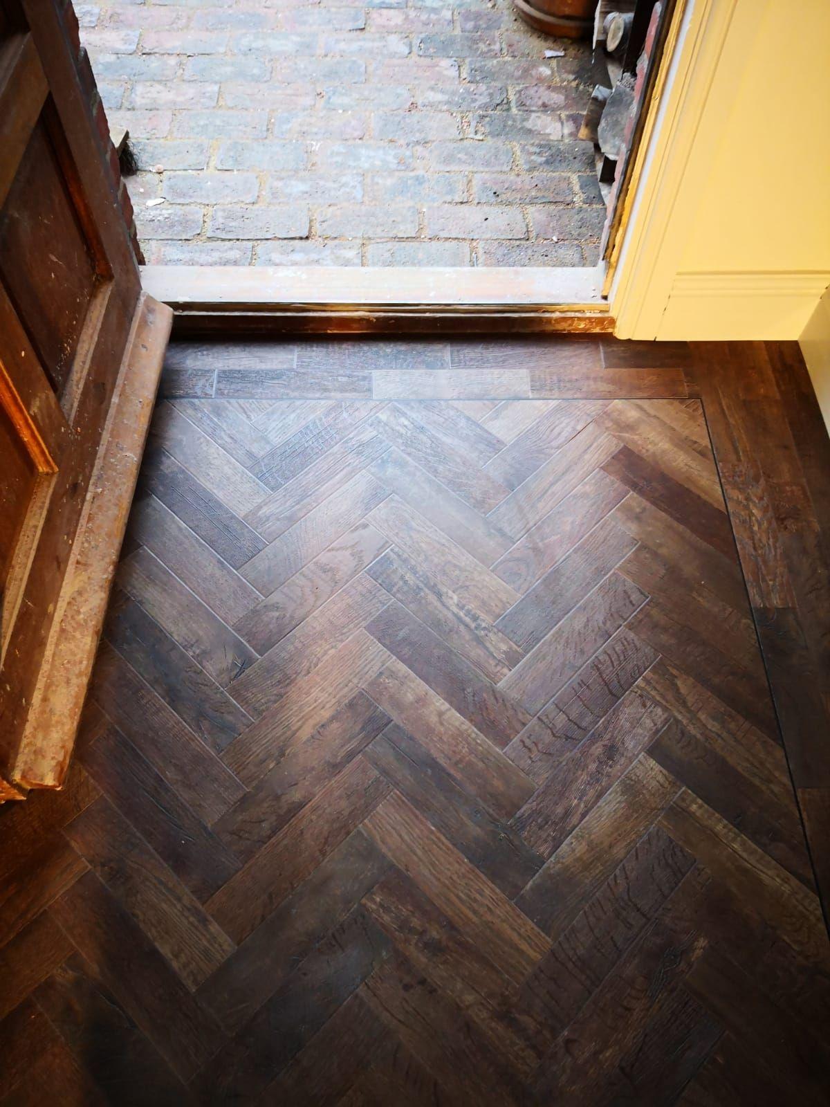 Stunning mahogany herringbone flooring which is striking