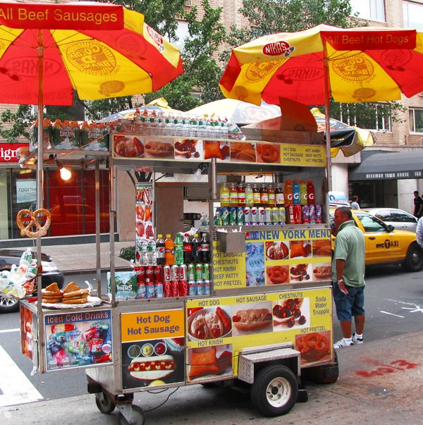 Eating a from hot dog stand in the city  | food wagons in