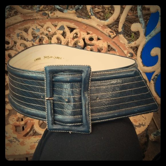 Vintage Yves Saint Laurent Wide Striped Navy Belt If you're a fan of tunic tops or drape sweaters, wide leather belts are a great way to cinch them in for a different look. This vintage classic is perfect for those scenarios. Not marked leather, but feels as such. Printed with gold Yves Saint Laurent logo/size. There is some wear beneath where the belt comes through the buckle (see last photo) and to the interior side, which is not visible when worn. Leather is textured similar to snakesin…