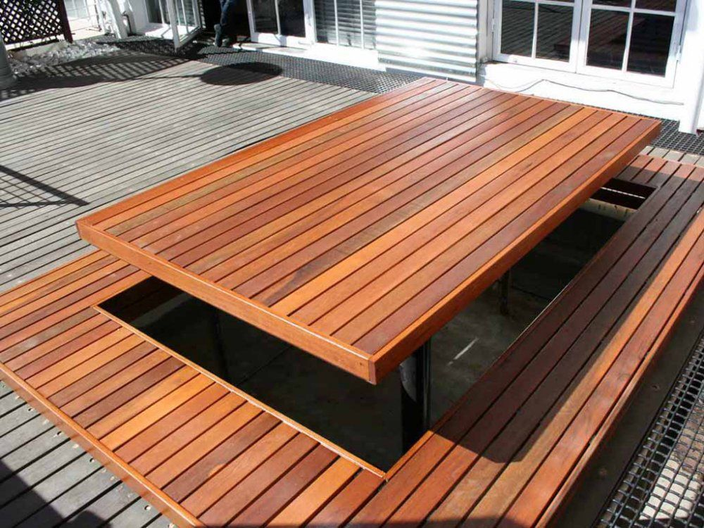 This Wooden Deck Has A Large Wooden Picnic Table