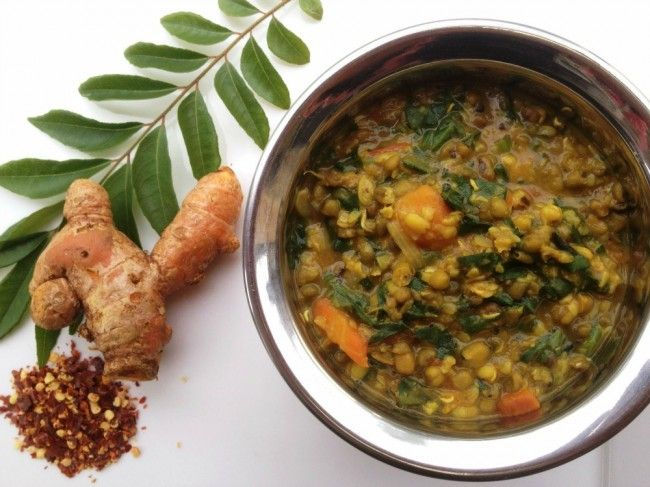 An Anti-inflammatory Mung Bean Curry Recipe Main Dishes with mung beans, coconut oil, brown mustard seeds, yellow onion, cumin seed, ginger, ground turmeric, chili powder, garlic, tomatoes, carrots, water, baby spinach leaves, sea salt