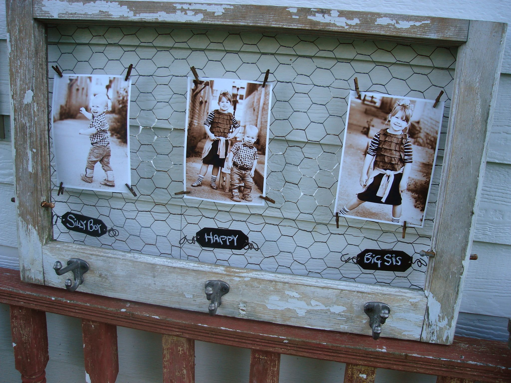 Great idea for an old window..add chicken wire....attach old photos ...
