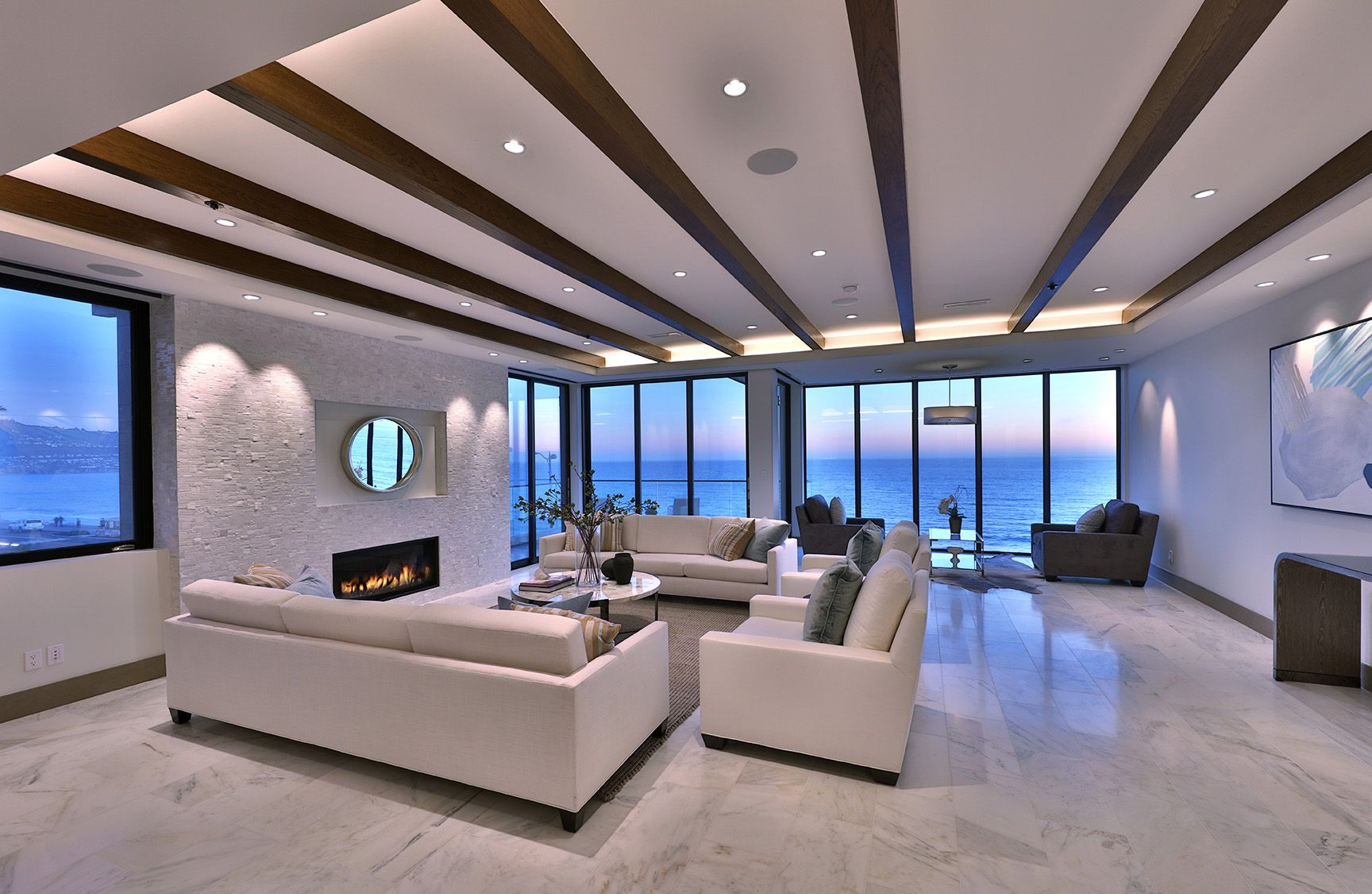 White Modern Luxury Living Room With Wood Beam Ceilings And Ocean View Living Room Design Modern Luxury Living Room Design Living Room Designs