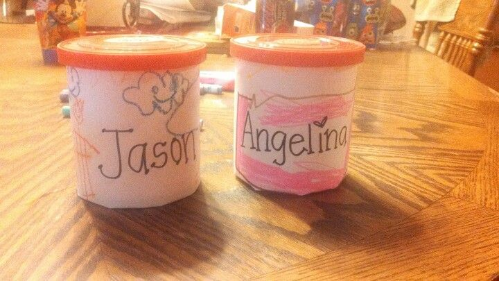 Using frosting container, paper, and crayons....you can have a great place to store crayons. Use at home or school :)
