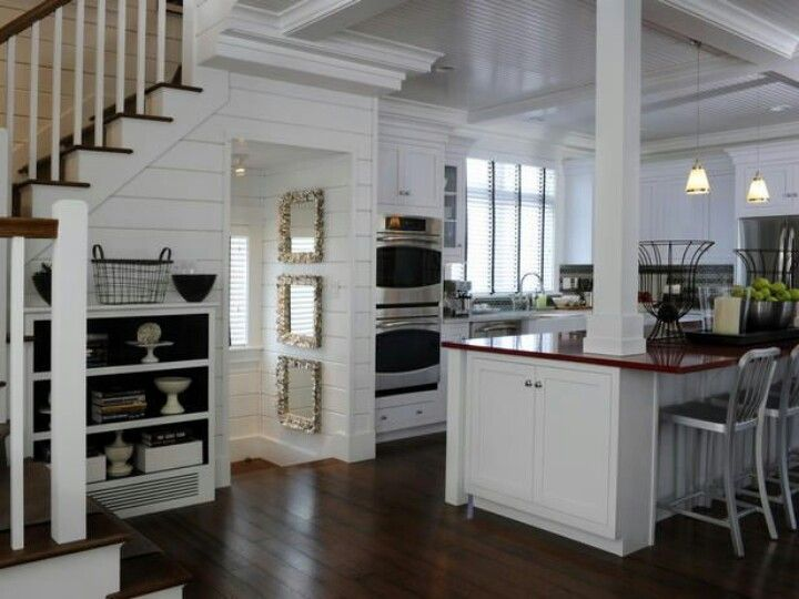 Open kitchen with beam.