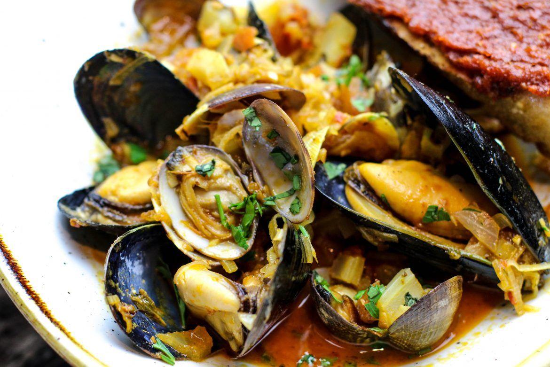 Harissa Clams And Mussels Saltys Com Recipe Smoked Tomatoes Harissa Harissa Recipes