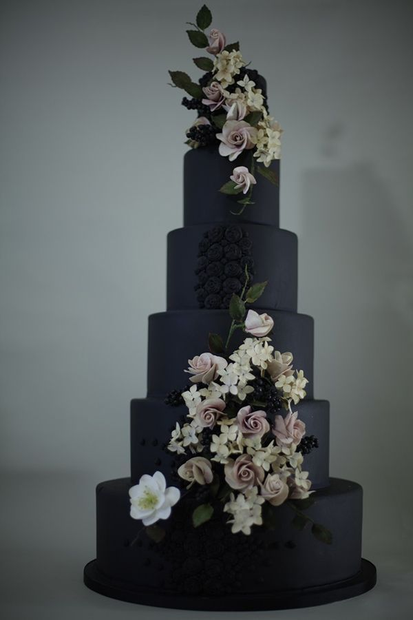 Designed by Victoria Made, this dramatic wedding cake features jet-black fondant accented with lifelike flowers, belladonna berries, and beading.  Save this pin and follow me for more inspiration!: @weddingtidbits