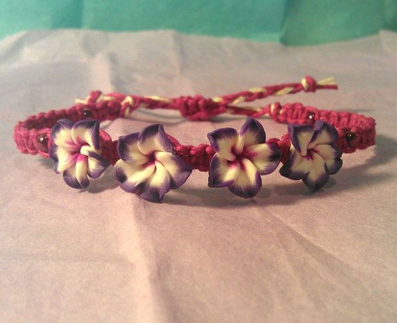 This handmade bracelet is made from dyed fuchsia hemp, with four small polymer plumeria beads and fuchsia chrome finish E beads. Each