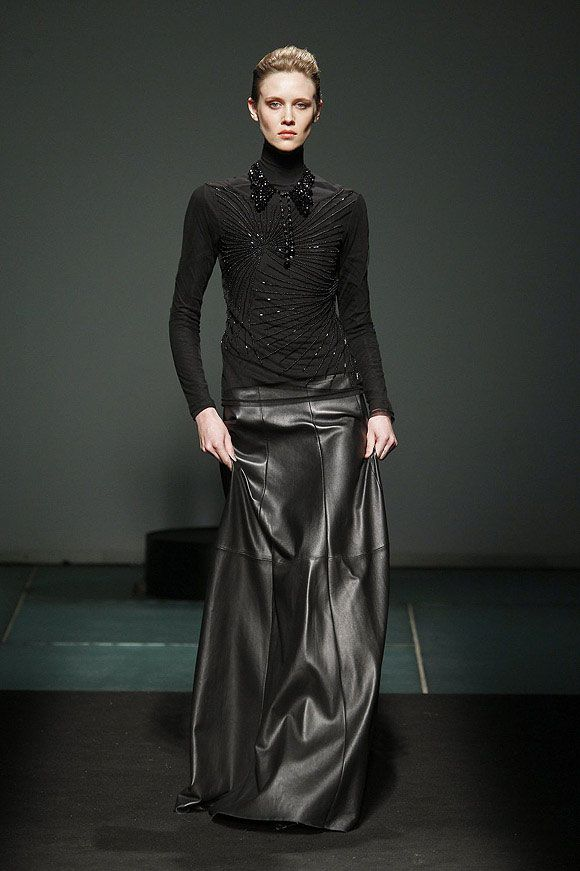 All black full length leather skirt and roll neck knitwear, Javier ...