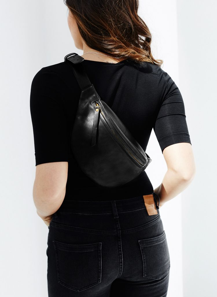 5548cf4f9d Oversized leather fanny pack by DAPHNY RAES. Shop with free worldwide  shipping.