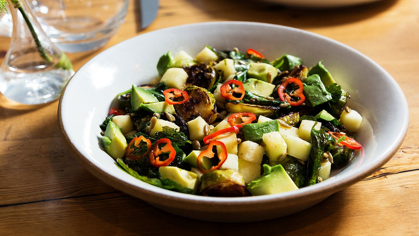 Dan Kluger shares his recipe for roasted Brussels sprouts drizzled with a mustard dressing and topped with apples and avocado.