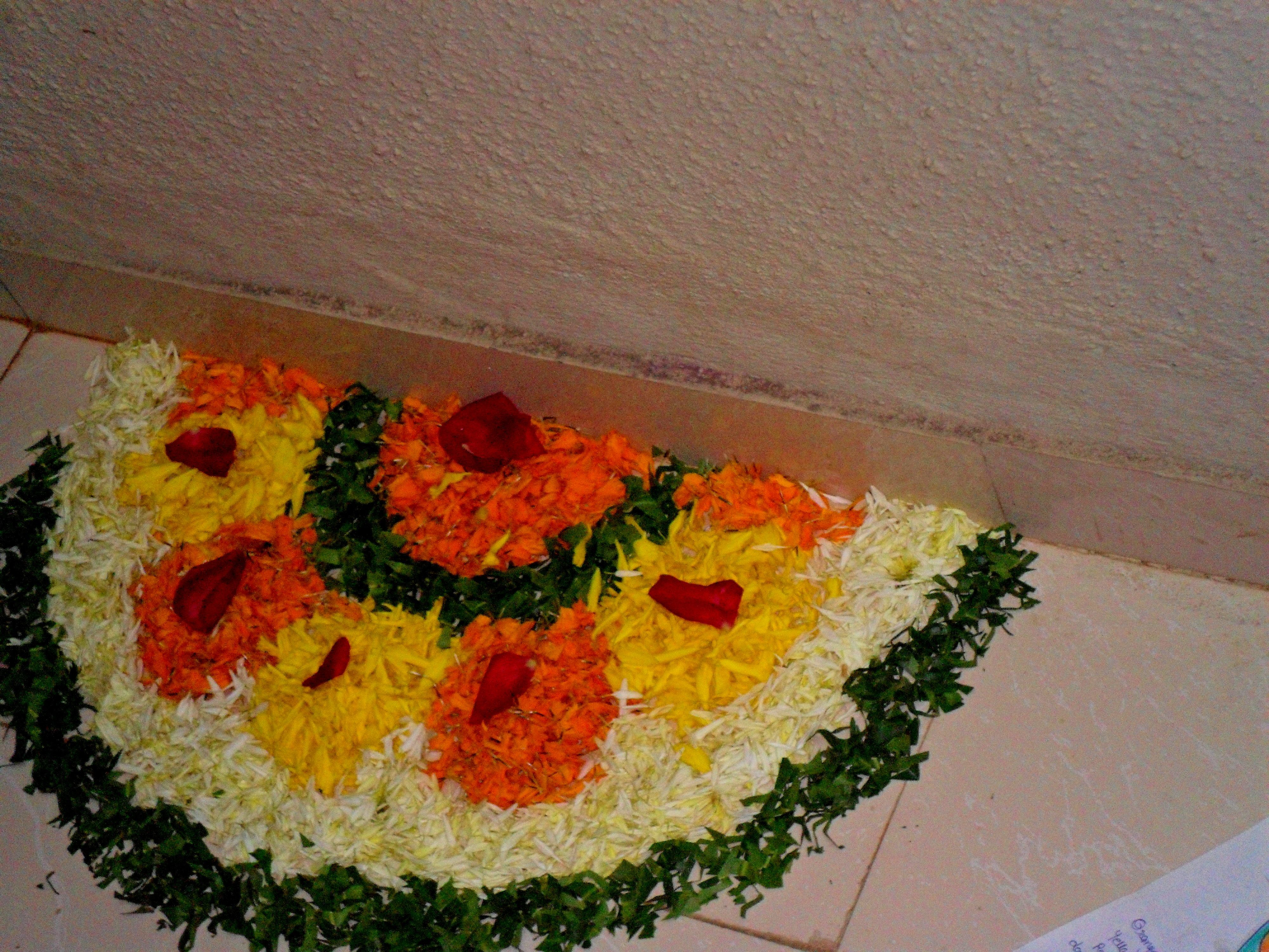 Flower rangoli.. Flower decorations, Flower rangoli
