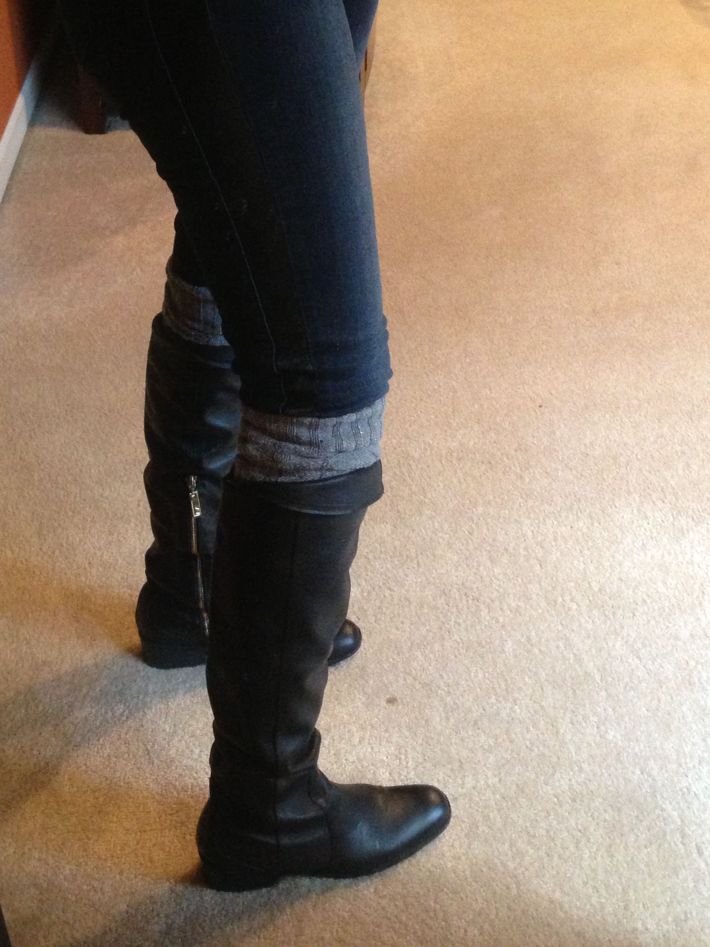 Matiko tall leather boots with gray sparkly leg warmers.