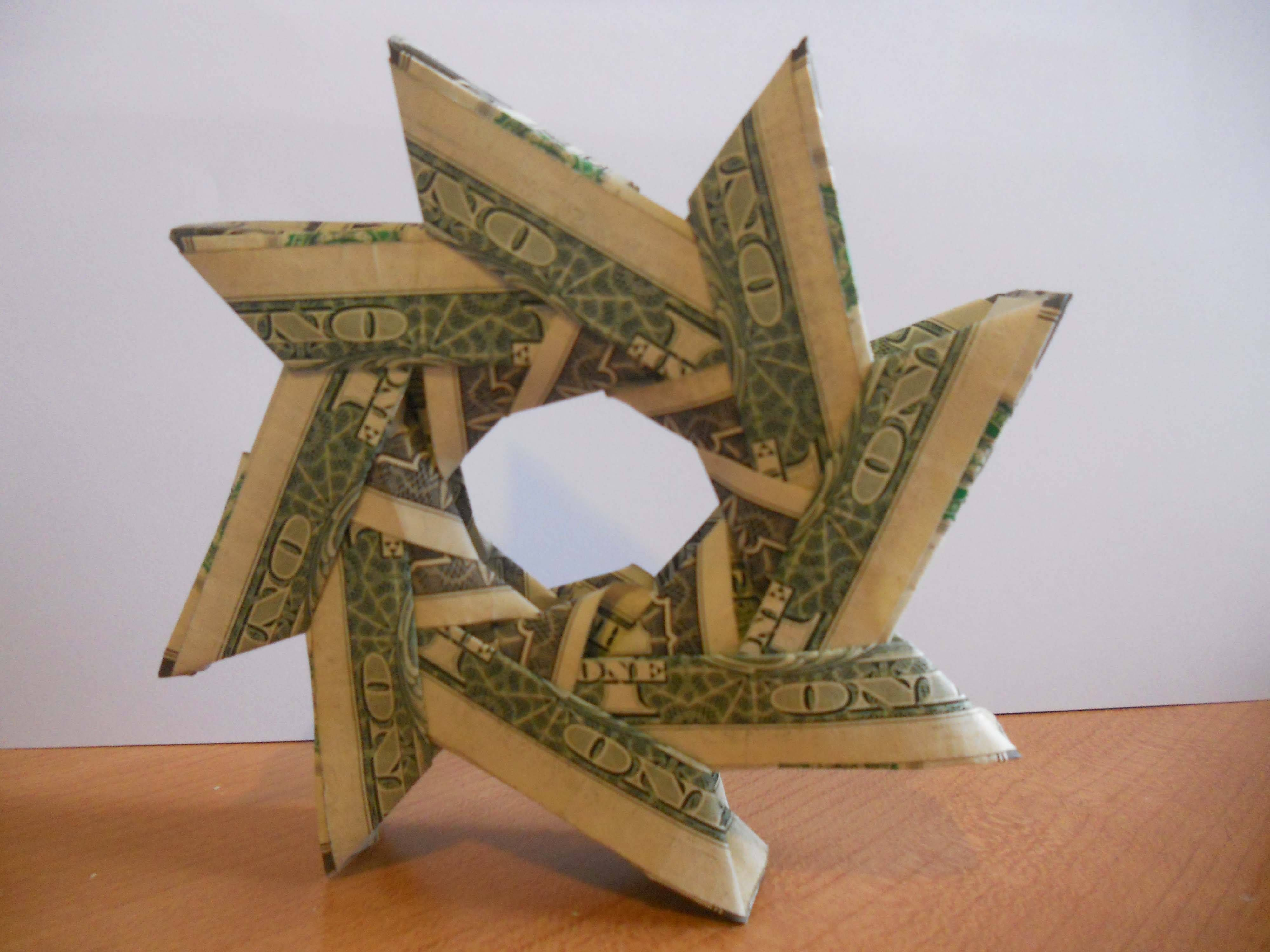 Learn all about the history of origami origami wreaths and a money origami wreath offers a fun yet memorable way to present a cash gift change the bill denominations as needed to accommodate your budget jeuxipadfo Image collections