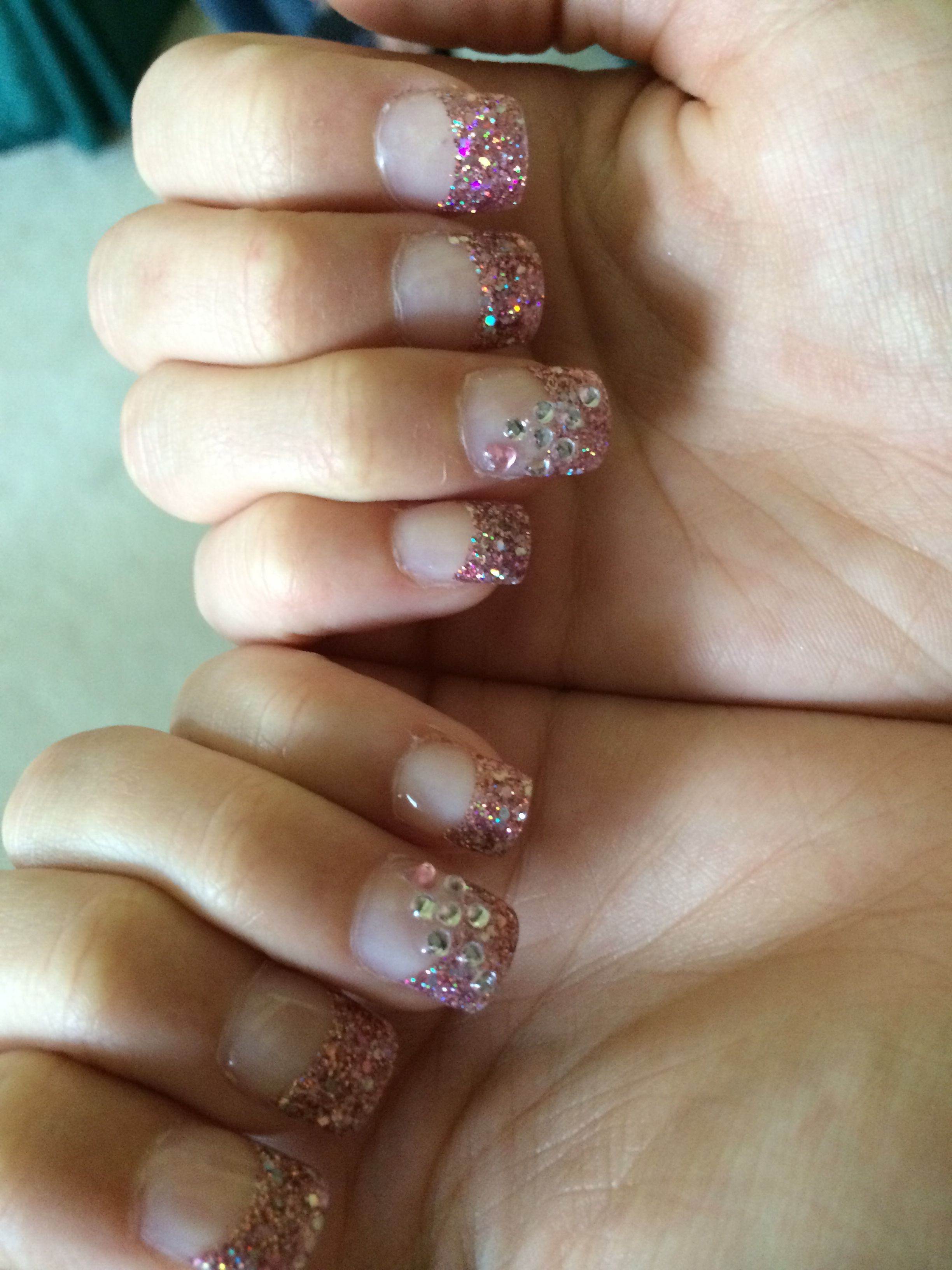 Pink champagne glitter tips with a bedazzled pink and white diamond ...