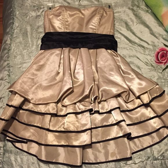Champagne/black strapless party dress 100% polyester. Dry clean only. Comes with black sash. Has a small spot on the front bottom frill (fourth pic). Side zip. Forever 21 Dresses Strapless