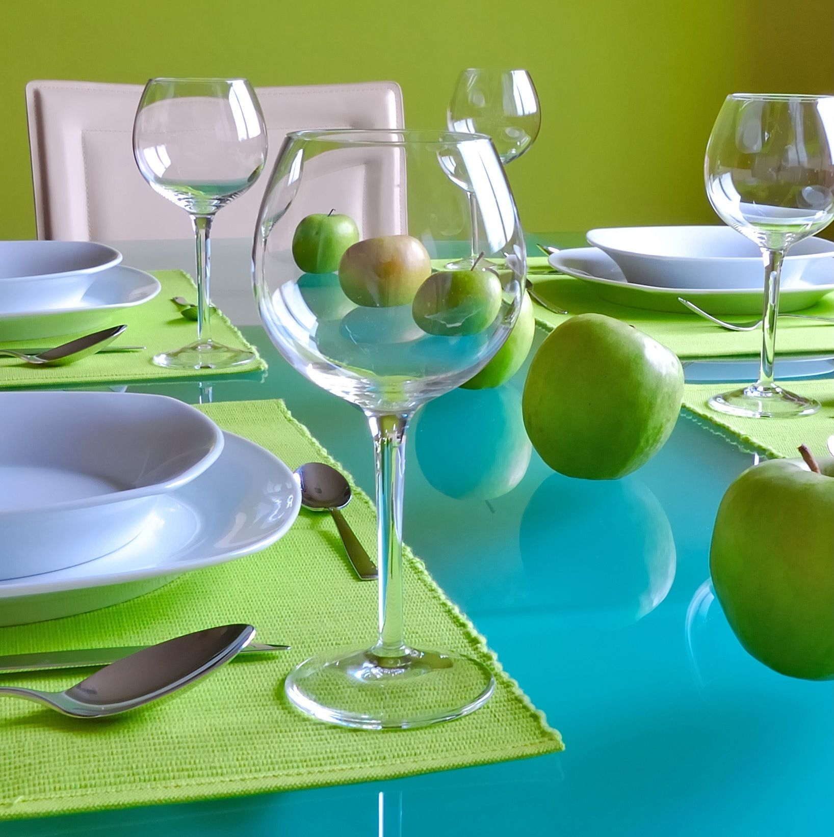 This Apartment Dining Room Is Stunning With A Blue Glass Table And Green Apple Wall Paint