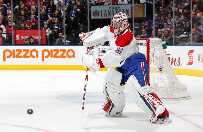TORONTO, ON - JANUARY 7: Carey Price #31 of the Montreal Canadiens plays the puck against the Toronto Maple Leafs during the second period at the Air Canada Centre on January 7, 2017 in Toronto, Ontario, Canada. (Photo by Kevin Sousa/NHLI via Getty Images)