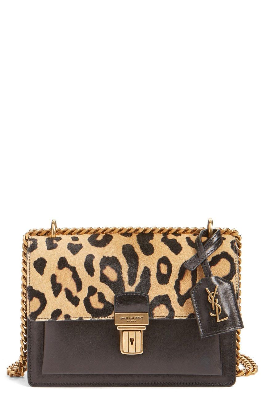 Leopard-print calf hair adds an exotic air to this structured calfskin satchel featuring impeccable Italian craftsmanship and a polished chain-link shoulder strap.