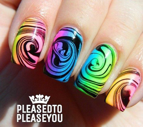 Another swirling marble nail art effect in neon colors against a ...