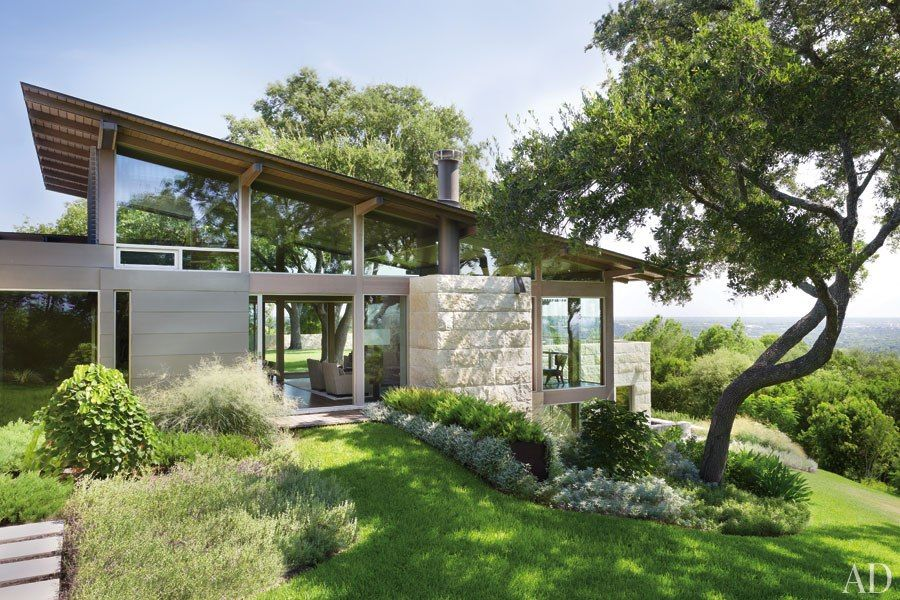 A hillside home in austin texas becomes a coveted Hill country style house plans