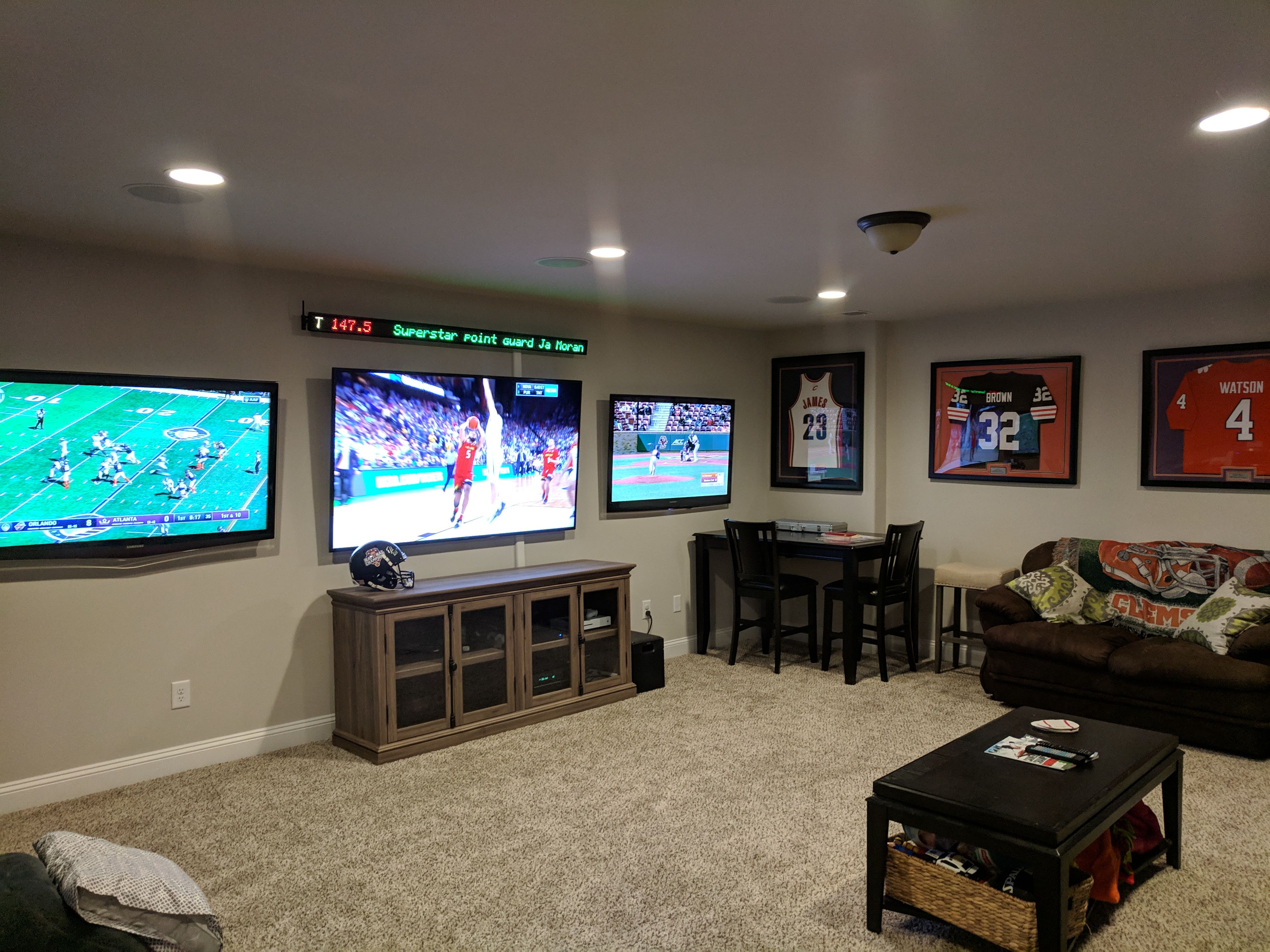 Spice Up Your Man Caves With A Home Sports Ticker Man Cave Living Room Sports Room Man Cave Small Media Rooms