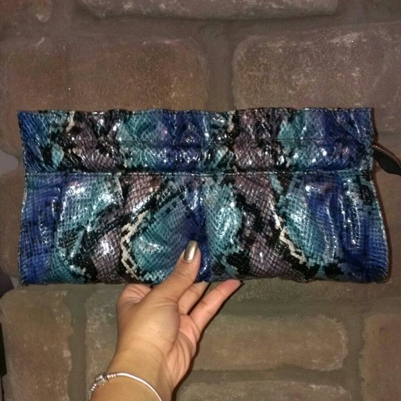 "Express Snakeskin Clutch This clutch is brand new, never used (still has paper inside). Variety of blue colors mixed with a dark grey color, it ruffles at the very top of the clutch and the ""EXPRESS"" imprint is on the inside of clutch. Express Bags Clutches & Wristlets"