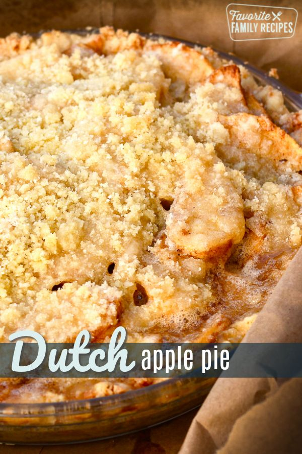 This Dutch Apple Pie is our favorite Fall pie. It is filled with tart apples and baked with a sweet and buttery crumb topping. #applepie